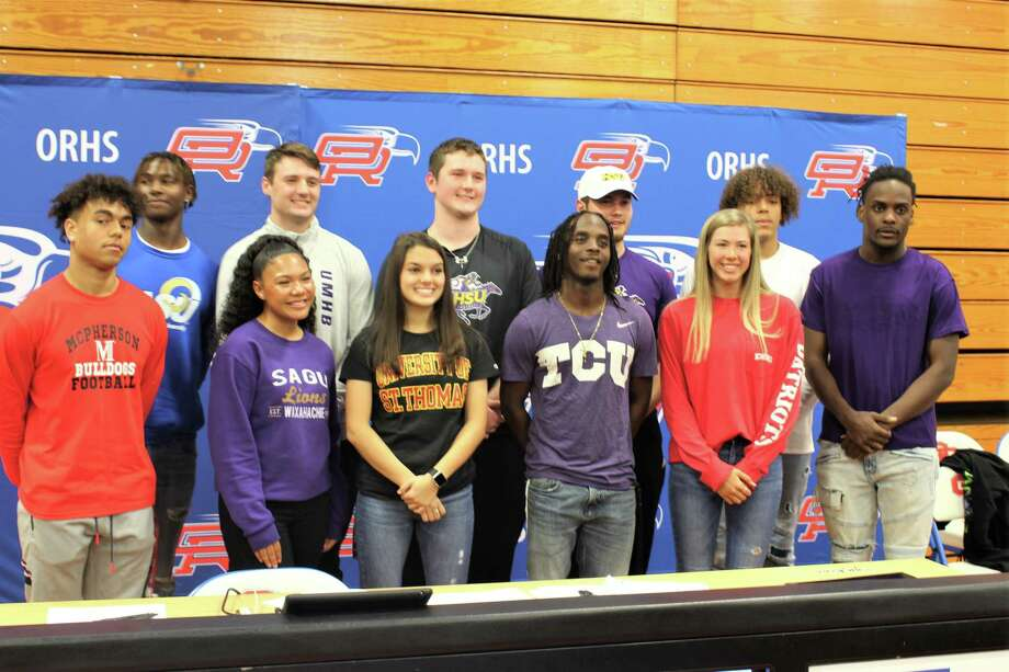 Oak Ridge saw 11 student-athletes, including eight football players, celebrate their college commitments on Wednesday morning. Photo: Jon Poorman