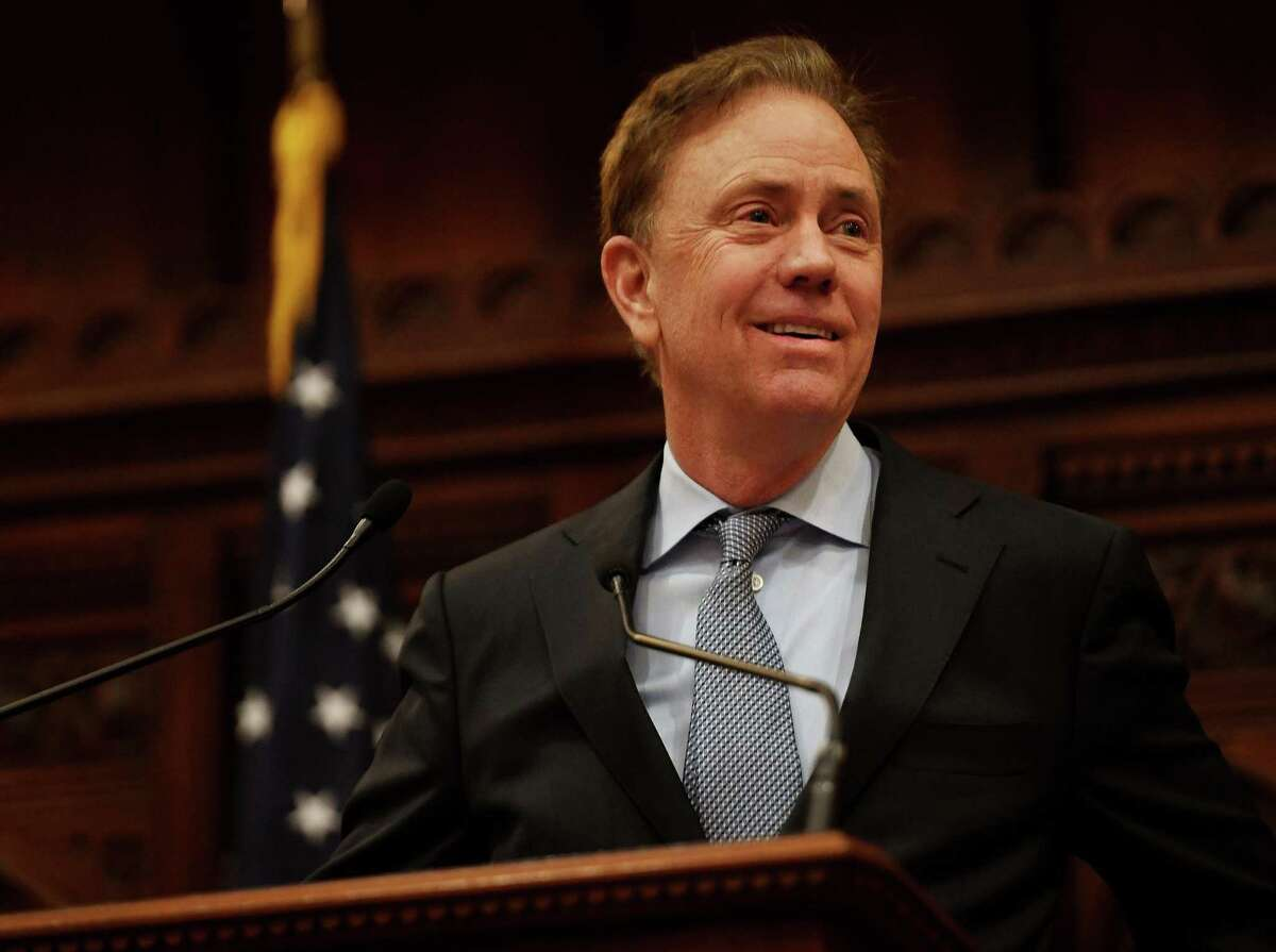 """Governor Ned Lamont addresses senators, representatives, and invited guests during the opening session of the state legislature in Hartford on Wednesday. """"Economic growth picked up last year,"""" Lamont said. """"That means businesses and young families are now giving Connecticut a second look."""