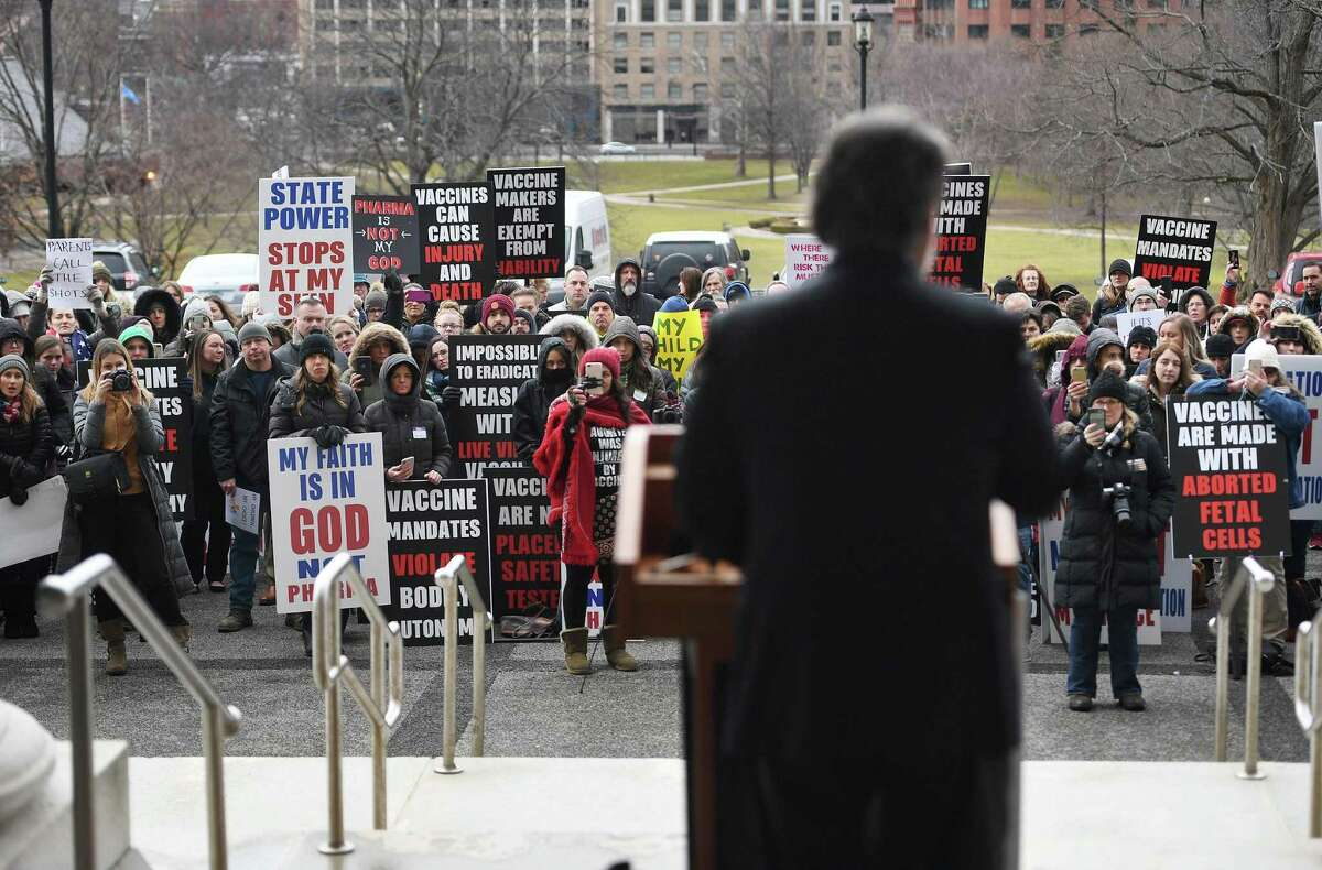 Rep. Jack Hennessy, D-Bridgeport, addressed anti-vaccine protesters during a rally on the back steps of the Capitol during opening session of the state legislature in Hartford, Conn. on Wednesday, February 05, 2020.