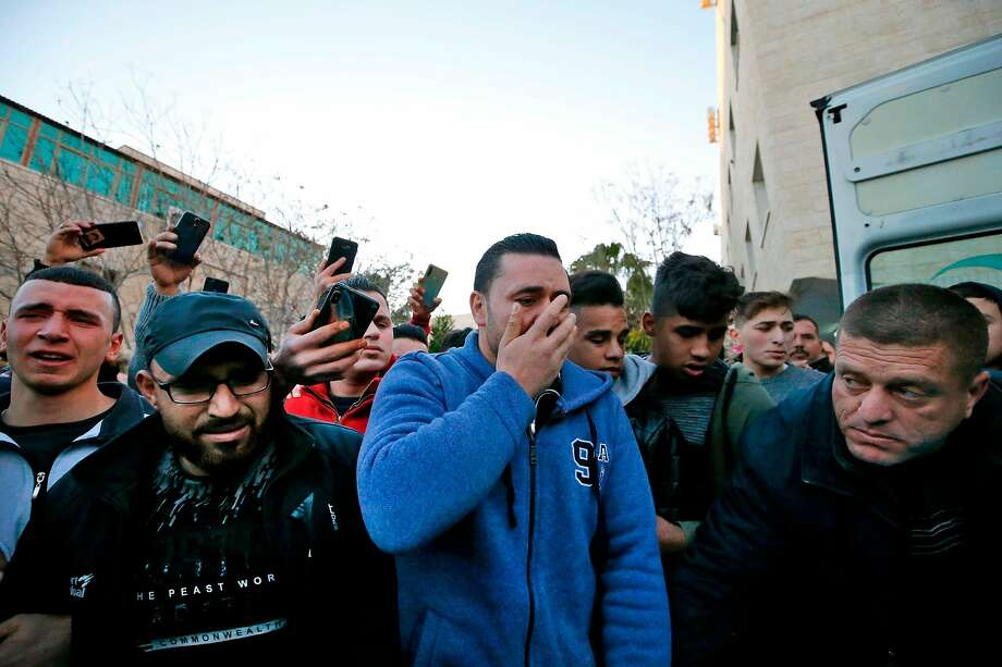 Relatives mourn Palestinian teen Mohammed al-Haddad, who was killed by Israeli forces in the West Bank city of Hebron. Photo: Hazem Bader/ AFP Via Getty Images