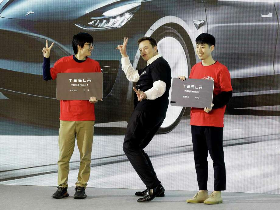 Tesla CEO Elon Musk gestures during a ceremony at the company's Gigafactory in Shanghai, China, on Tuesday. Tesla kicked off production in China heralding what could be the dawn of real competition in the world's largest EV market. MUST CREDIT: Bloomberg photo by Qilai Shen Photo: Qilai Shen / Bloomberg / Bloomberg