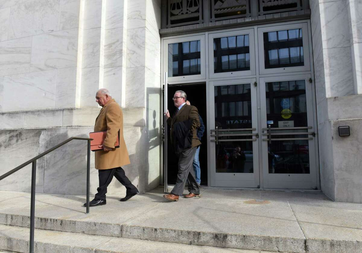 Former Cohoes mayor Shawn Morse, center, leaves the James T. Foley Federal Courthouse after being sentenced for a federal wire fraud conviction on Wednesday, Feb. 5, 2020, in Albany, N.Y. His attorney, Bill Dwyer, left, leads the way. (Will Waldron/Times Union)