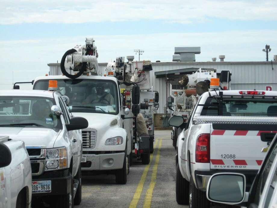 Entergy Texas rolling stock, including off-road, yard, pickups and bucket trucks -- 42 pieces in all, begin to depart the utility's service center on 11th Street with Baton Rouge as their destination to restore power to more than 700,000 people after Hurricane Isaac passed through. Photo: Dan Wallach / Dan Wallach