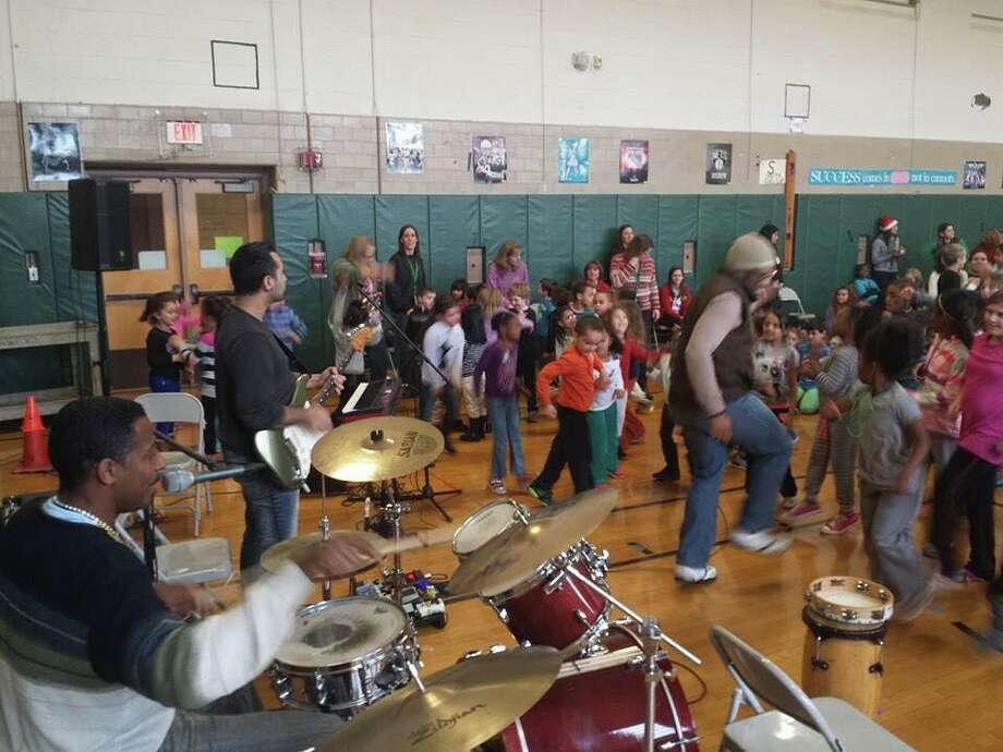 Boogie Chillun', a five-piece diverse, multicultural group, will perform at Stamford's Ferguson Library as part of a celebration for the ninth annual international Take Your Child to the Library Day on Feb. 22. Photo: Facebook