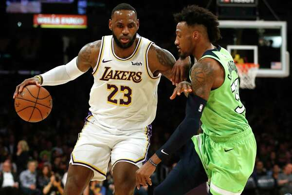 Robert Covington (right) likely won't be on hand to guard LeBron James on Thursday, but the long-armed and versatile defender is expected to be a fit in the Rockets' switching style and defend bigger opponents.