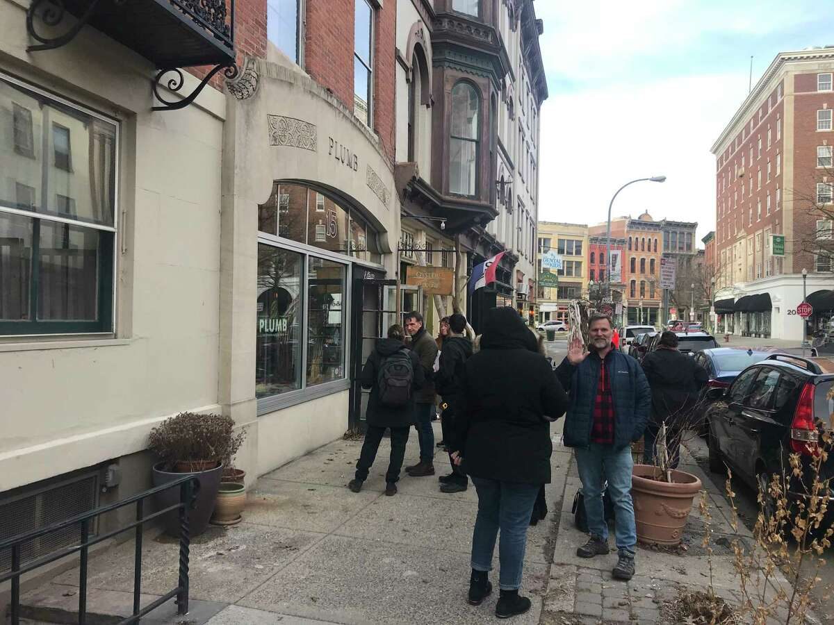 """A crowd of location scouts and artists from HBO's """"The Gilded Age"""" television series were working on Second Street near Broadway in Troy, N.Y. Wednesday Feb. 5, 2019 reviewing the building exteriors in preparation for the filming of the series later this year."""