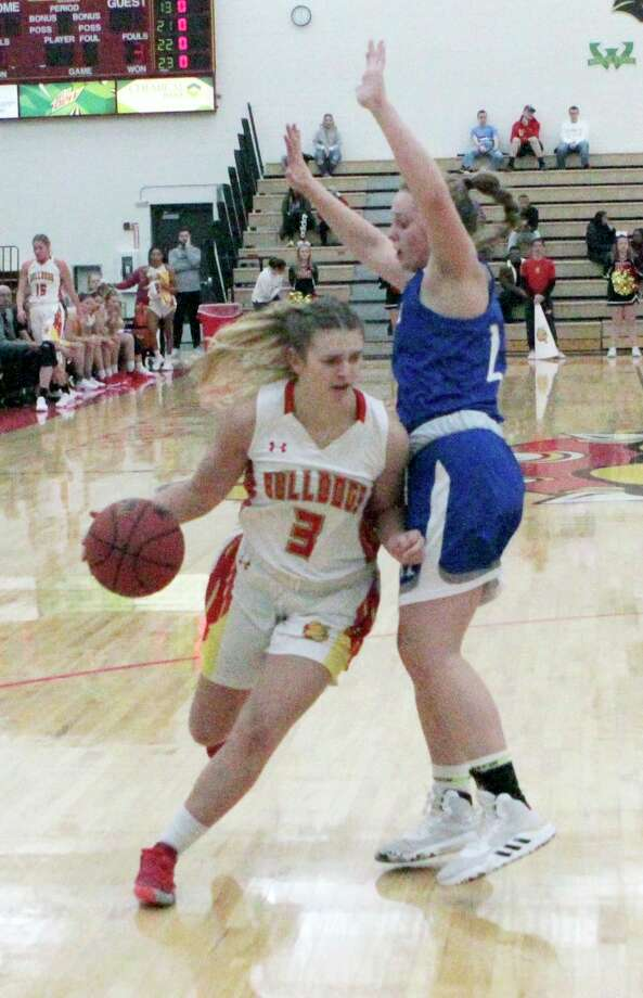Ferris State senior guard Renee Sturm attempts to dribble past an opponent during action earlier this season. (Pioneer file photo/Joe Judd)