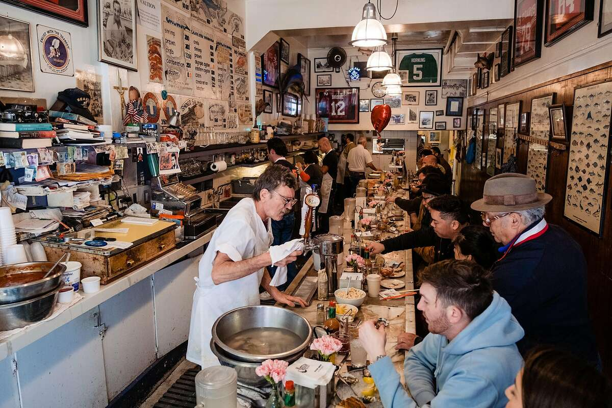 Customers eat lunch at the Swan Oyster Depot in San Francisco, Calif. on Wednesday, February 5, 2020.