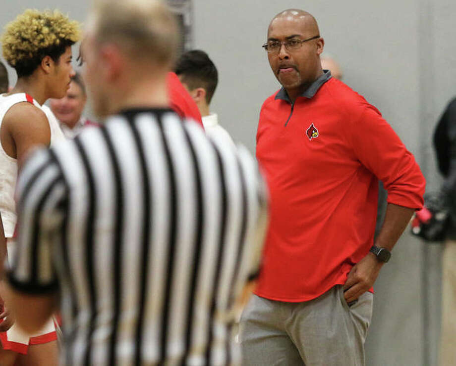 Alton coach Dana Morgan looks toward an official after breaking from a timeout in a game Nov. 27 at Alton High in Godfrey. Plans are already being made for next season's bigger and better Alton Shootout after the inaugural event Saturday at AHS. Photo: Greg Shashack / The Telegraph
