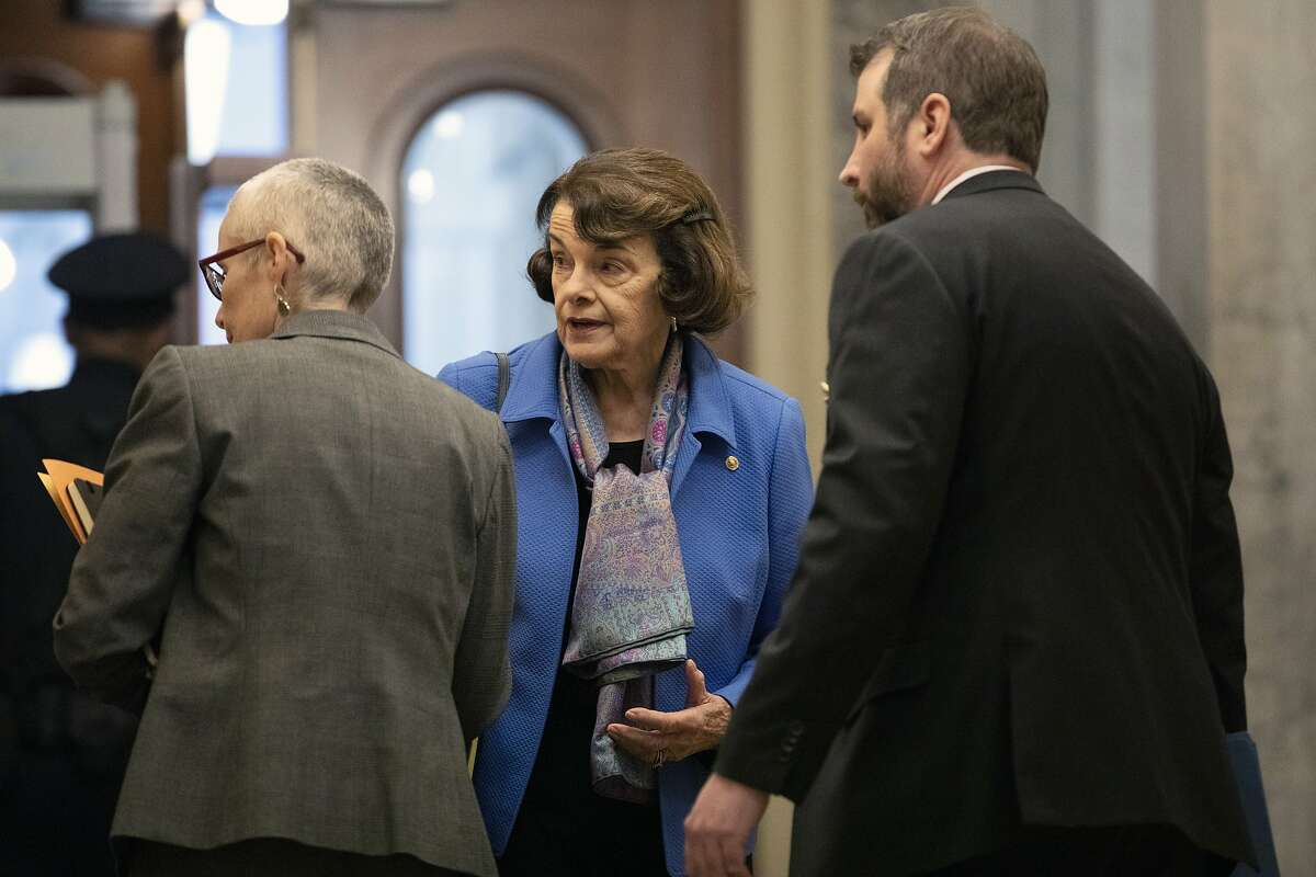 Sen. Dianne Feinstein, D-Calif., center, arrives on Capitol Hill in Washington, Friday, Jan. 31, 2020, for the impeachment trial of President Donald Trump on charges of abuse of power and obstruction of Congress. (AP Photo/ Jacquelyn Martin)