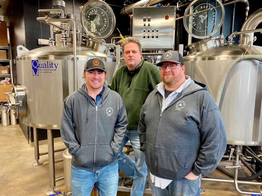 Shown from left, Jamieson Hanna, assistant brewer; Brian Decker, general manager and Bill Joslyn, head brewer of North Channel Brewing Company. The brewery was awarded a $100,000 grant toward expansion into canning beer for retail purchase.