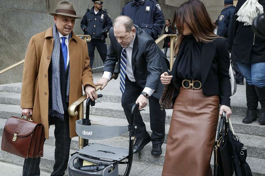 Harvey Weinstein (center) departs a Manhattan courthouse. Six women have testified against the former movie mogul. Photo: John Minchillo / Associated Press