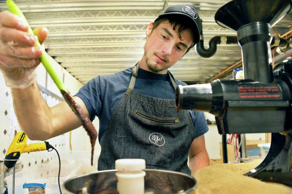 Single origin chocolate maker Oliver Holecek of Troy, works his bean to bar production process in his Primo Botanica production facility at Stable Gate Farms in Castleton on Hudson, NY. (John Carl D'Annibale/Times Union)