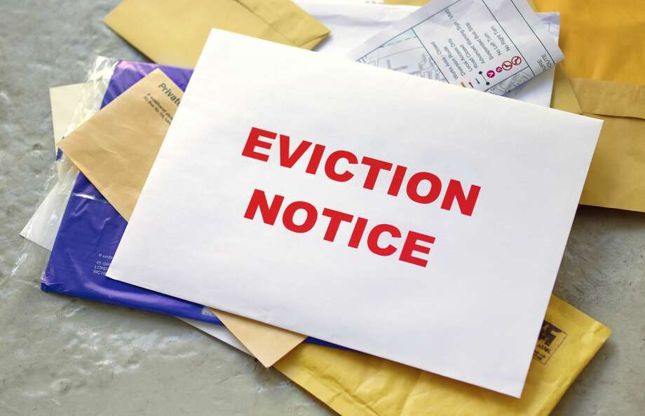 Eviction notice in the post Photo: Peter Dazeley/Getty Images