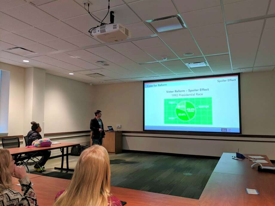 Ferris students and area residents alike listened to a presentation about ranked choice voting Wednesday evening. The event was hosted by thePolitical Engagement Project and CLACS with guest speakers from RankedMIVote. (Pioneer photo/Catherine Sweeney)