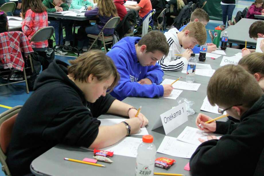 Middle school students from the Onekama Consolidated Schools take part in the MathCounts competition at West Shore Community College on Wednesday afternoon. Mort than 200 students took part in the program. (Ken Grabowski/News Advocate)