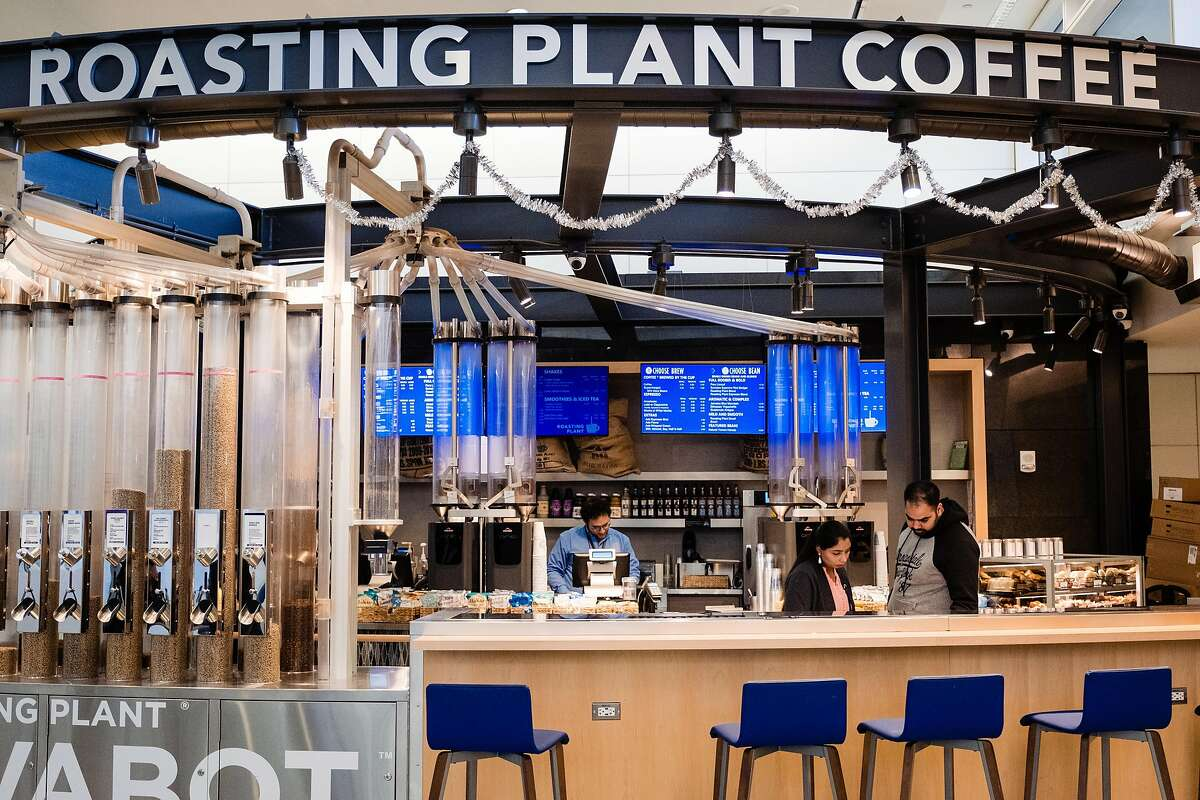 Customers wait for their coffee at the Roasting Plant Coffee shop at San Francisco International Airport in San Francisco, Calif. on Tuesday, February 4, 2020.