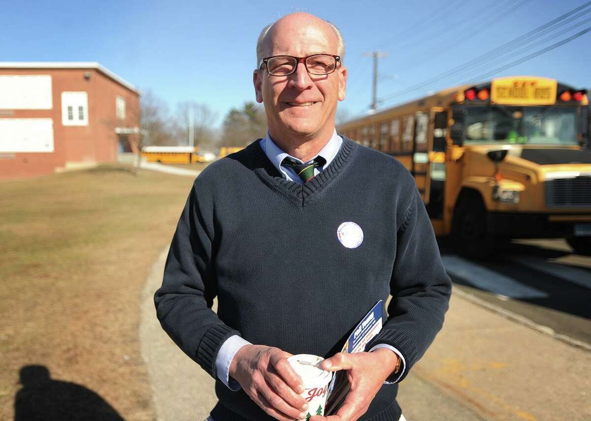 Phil Young campaigns outside the polls at Wooster Middle School in Stratford, Conn. on Tuesday, February 27, 2018.