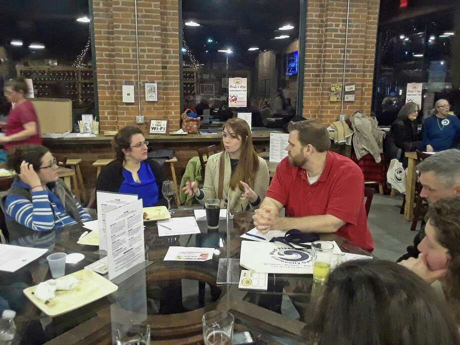 Members of the Mad River Market food co-op, who hope to establish a community-owned grocery store in Winsted, held a brainstorming session and informational meeting Tuesday night with local farmers at Little Red Barn Brewers. Co-op board members Meg Raino, third from left, and Joel Stewart, right, talk with farmers during the meeting. Photo: Emily M. Olson / Hearst Connecticut Media /