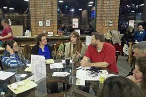 Members of the Mad River Market food co-op, who hope to establish a community-owned grocery store in Winsted, held a brainstorming session and informational meeting Tuesday night with local farmers at Little Red Barn Brewers. Co-op board members Meg Raino, third from left, and Joel Stewart, right, talk with farmers during the meeting.
