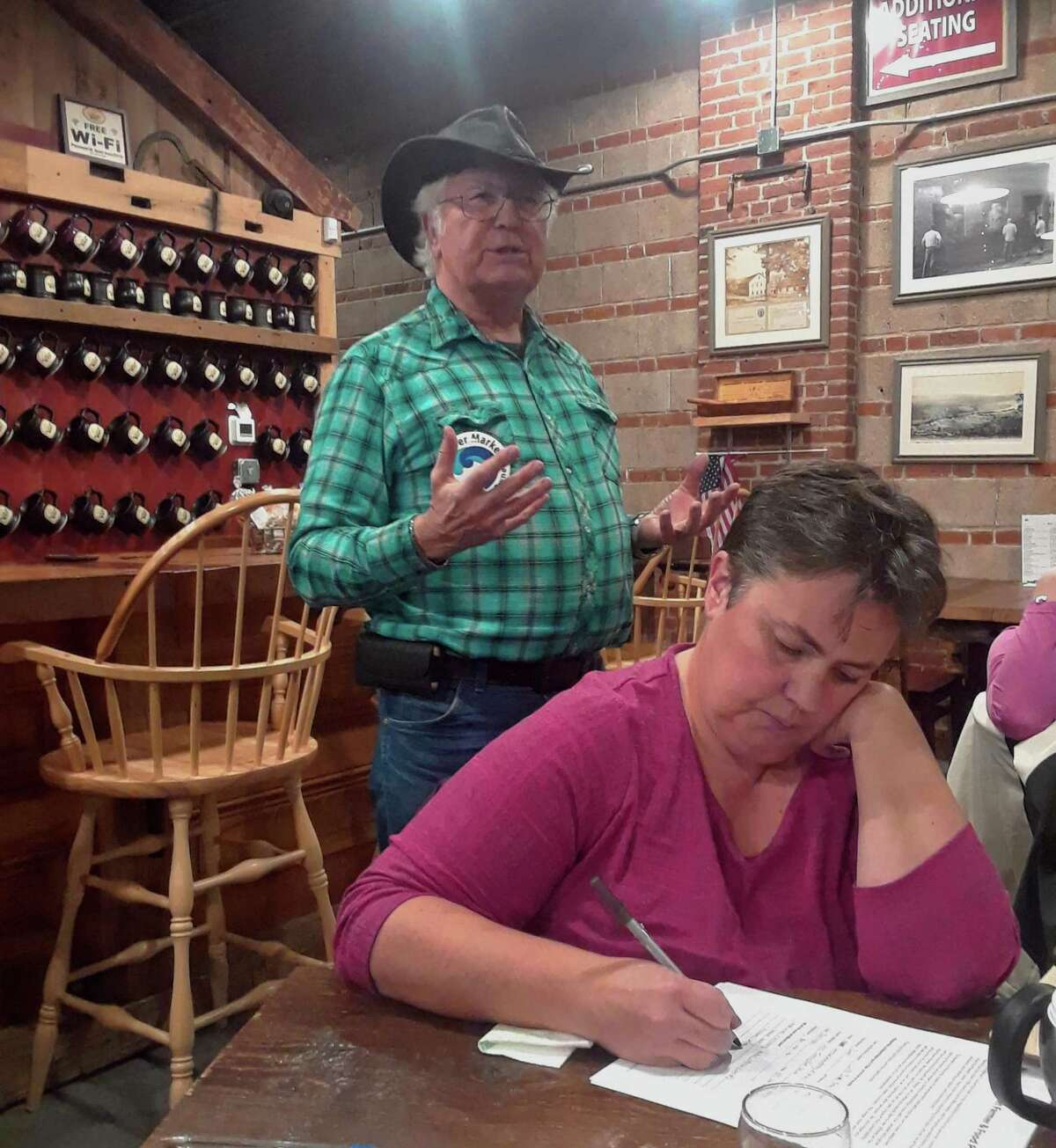 Members of the Mad River Market food co-op, who hope to establish a community-owned grocery store in Winsted, held a brainstorming session and informational meeting with local farmers at Little Red Barn Brewers Tuesday night. Above, co-op board president Glen Zeh greets guests at the meeting.