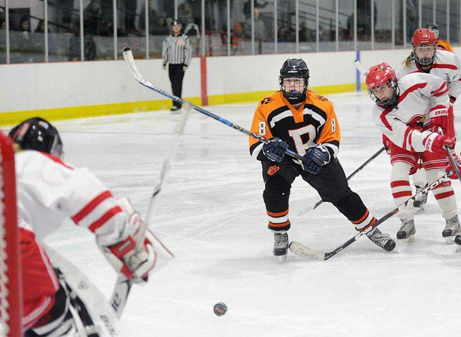 Emily Stefanelli takes a backhand shot in a game against Greenwich last season. Photo: Bob Luckey Jr. / Hearst Connecticut Media