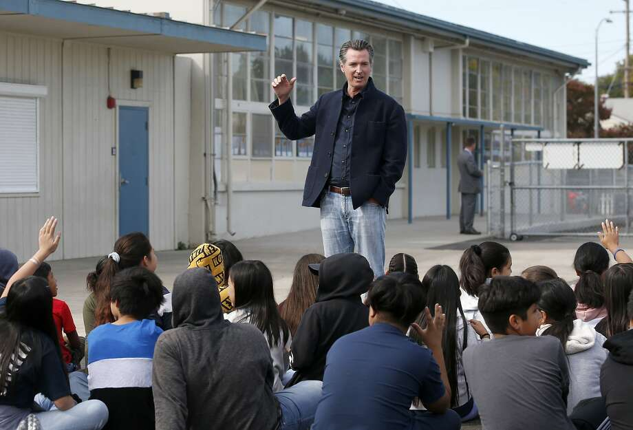 FILE - In this Monday Oct. 7, 2019 file photo, California Gov. Gavin Newsom talking to students during his visit to the Ethel I. Baker Elementary School in Sacramento, Calif. Newsom wants a three-year suspension on physical fitness tests while the state studies whether the current test for children in fifth, seventh and ninth grades can be modified or a new assessment should be drawn up. (AP Photo/Rich Pedroncelli, File ) Photo: Rich Pedroncelli / Associated Press