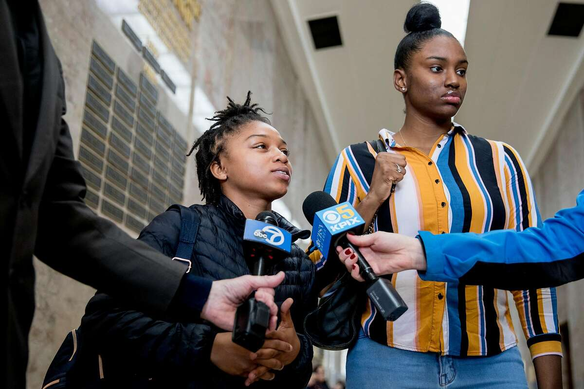 (From left) Danielle Brown and Crystal Clark, family friends of the late Mia Wilson, speak with reporters before entering the courtroom for the trial against her killer, John Cowell, at the Rene C. Davidson Courthouse in Oakland, Calif. Wednesday, February 5, 2020.