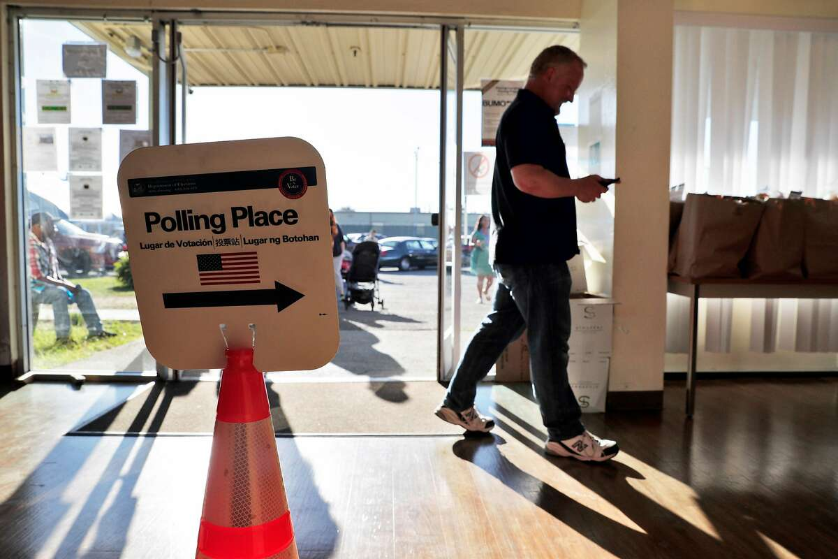 Bryn Smith, polling inspector for the Shipshape Community Center voting location, Treasure Island's only polling location, checks for voters during the mid afternoon in San Francisco, Calif., on Tuesday, November 6, 2018.