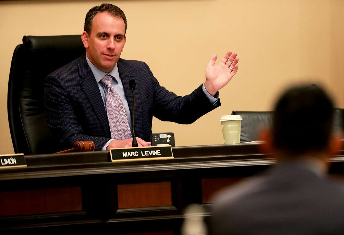"""Assemblymember Marc Levine addresses David Hickey, vice president, business and government sales, Verizon, during the Verizon Wireless """"Data Throttling"""" of Mendocino Complex Firefighters' Internet Access hearing at the California State Capitol, in Room 126, in Sacramento, Calif., on Friday, August 24, 2018. The Assembly Select Committee, Natural Disaster Response, Recovery, and Rebuilding, held the hearing at the Capitol to investigate the data throttling Verizon imposed on Santa Clara firefighters' communications system last month as they were battling the Mendocino Complex fires."""