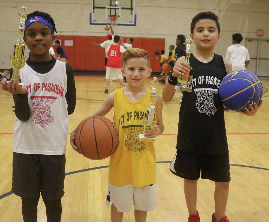 The 7 and 8-year-old trophy winners in the boys division featured Kai Tillman, Anthony Slattery and Adam Palomares. Photo: Robert Avery