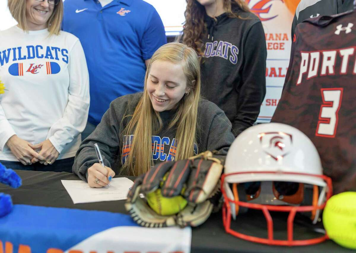 Stella Shaw, from Porter high school, signs with Louisiana College for football during National Signing Day at Randall Reed Stadium in New Caney, Wednesday, Feb. 5, 2020.