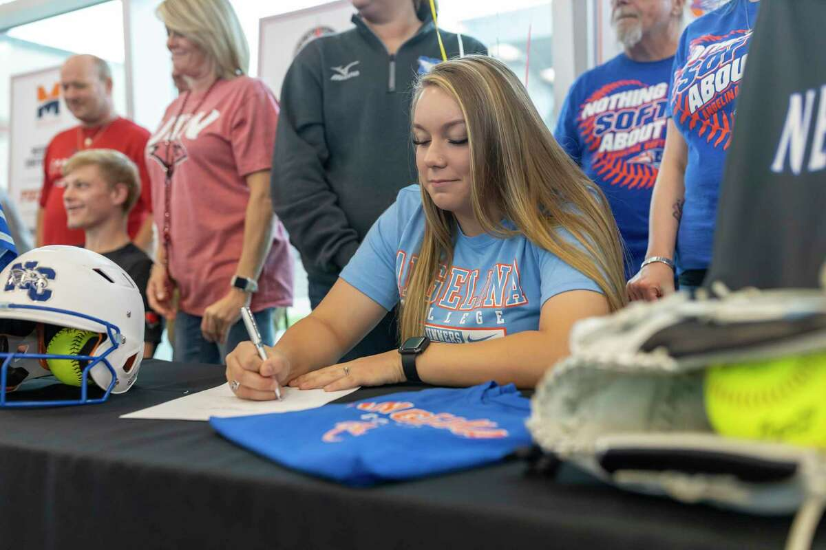 New Caney softball pitcher Bailee Weaver signed with Angelina College earlier this year.