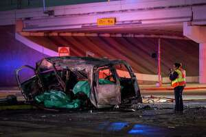 A van involved in a crash on Antoine Drive at the North Sam Houston Parkway underpass is photographed for evidence on Wednesday, Feb. 5, 2020, in Houston.