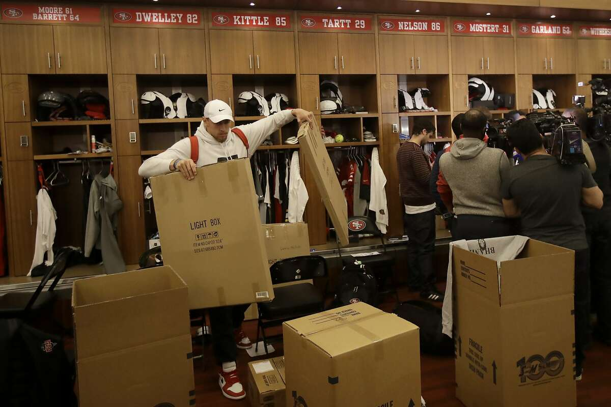 San Francisco 49ers' George Kittle carries his belongings from in front of his locker at the team's NFL football training facility in Santa Clara, Calif., Wednesday, Feb. 5, 2020. (AP Photo/Jeff Chiu)