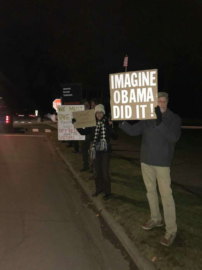 Demonstrators standing by the roadside with signs protesting the U.S. Senate's decision to acquit President Donald Trump on Feb. 5. Photo: / Josh LaBella