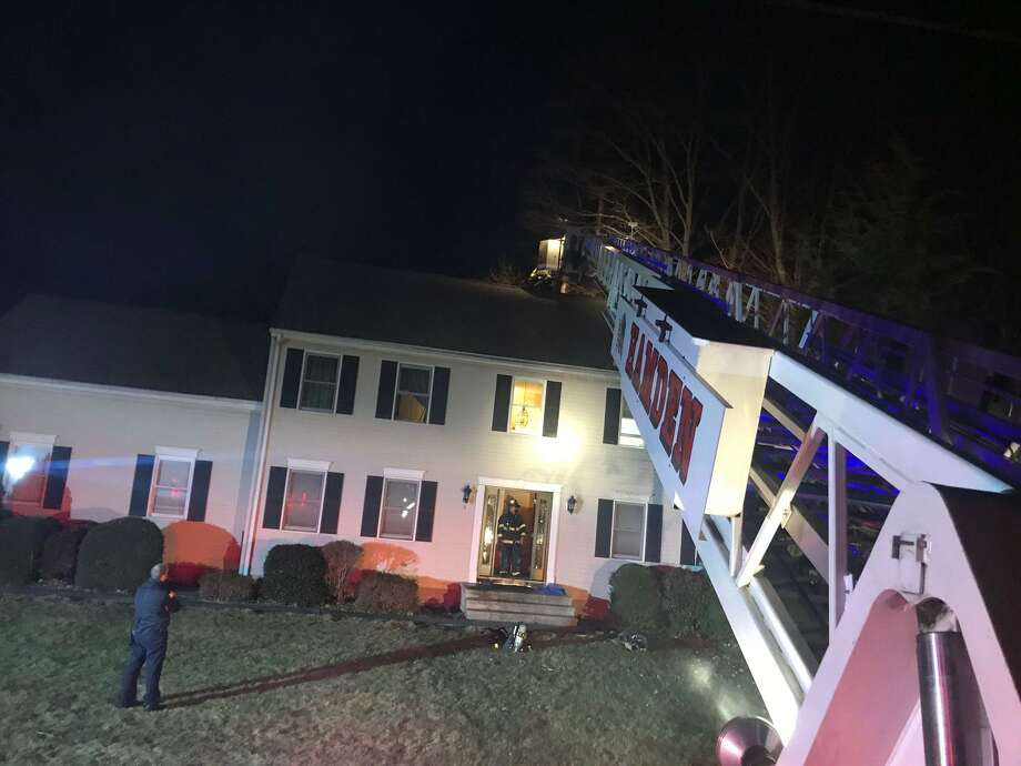 Firefighters on scene for a chimney fire in Hamden, Conn., on Wednesday, Feb. 5, 2020. Photo: Contributed Photo / Hamden Fire Department