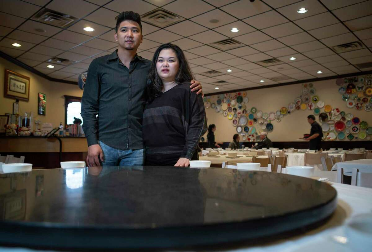 Mala Sichuan Bistro owners Heng Chen and Cori Xiong, shown in their restaurant in Houston Wednesday, Feb. 5, 2020, have watched business at their restaurant steadily drop since the coronavirus scare started. The couple has seen their business drop between 35 percent to 60 percent.