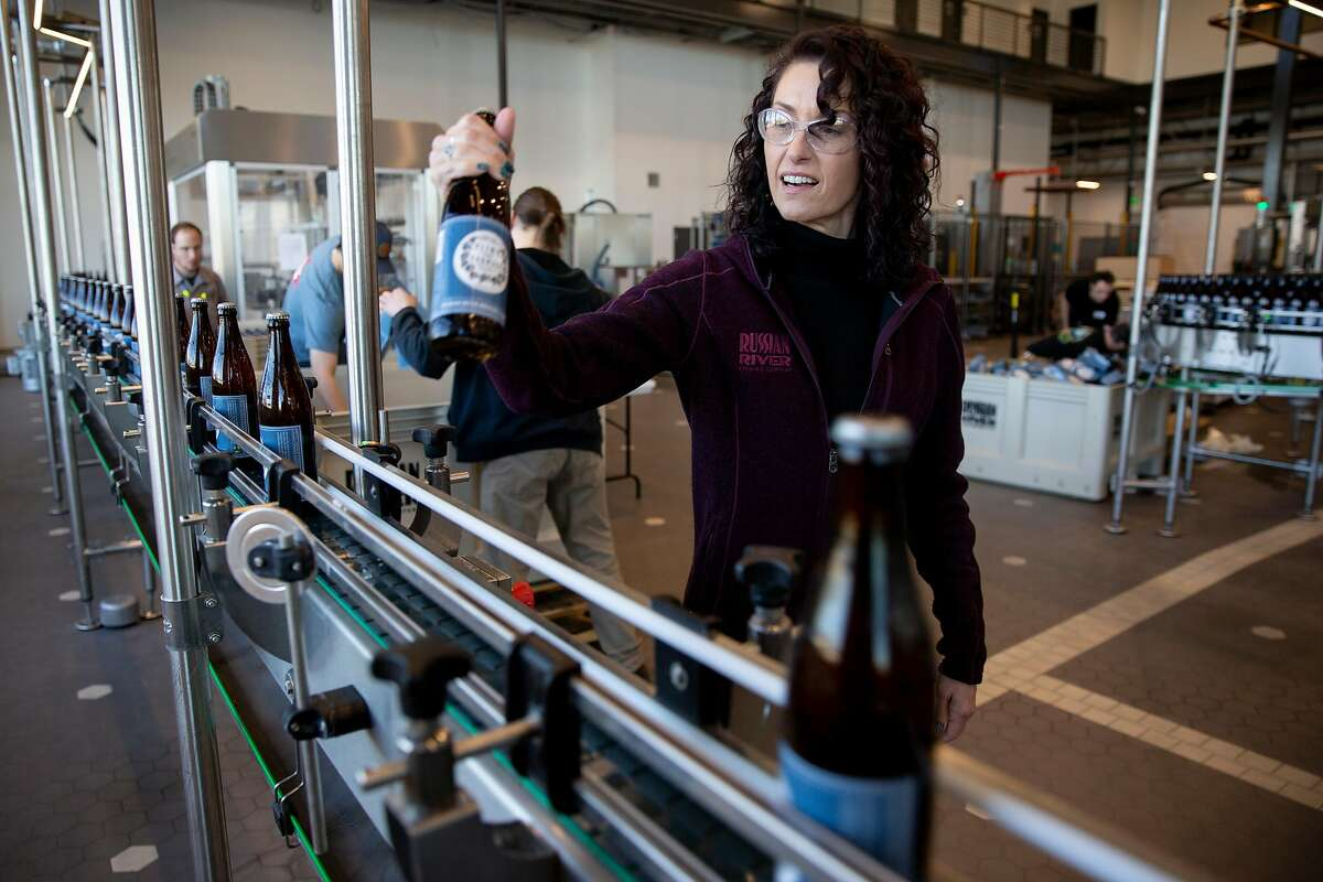 Natalie Cilurzo observes the Pliny the Younger beer being bottled at the Russian River Brewing Company, Wednesday, Feb. 5, 2020, in Windsor, Calif. Cilurzo is the co-owner of the company.