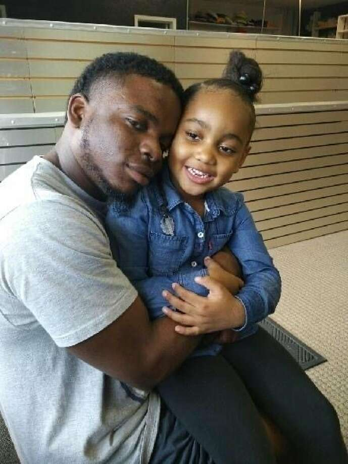 """This file photo provided by the family of Michael Dean shows Dean with his daughter Te'yana. Dean was killed Dec. 2, 2019, in Temple, Texas, located 70 miles northeast of Austin. A Texas police officer who fatally shot Dean, an unarmed man, in the head in December opened fire while the pair had """"an altercation of some sort,"""" according to a report filed on Dec. 30, in compliance with a law meant to provide more transparency in police shootings. (Courtesy from Michael Dean Family via AP, File) Photo: Associated Press"""