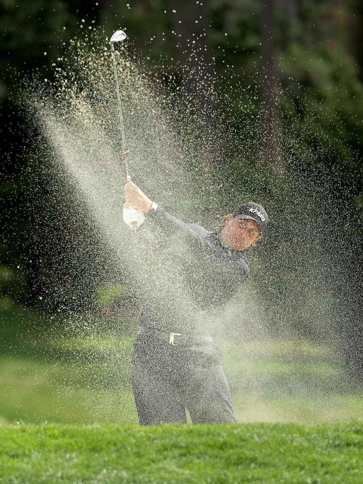 PEBBLE BEACH, CA - FEBRUARY 11: Phil Mickelson plays his shot from the bunker on the 13th hole during the Final Round of the AT&T Pebble Beach Pro-Am at Pebble Beach Golf Links on February 11, 2018 in Pebble Beach, California. ~~