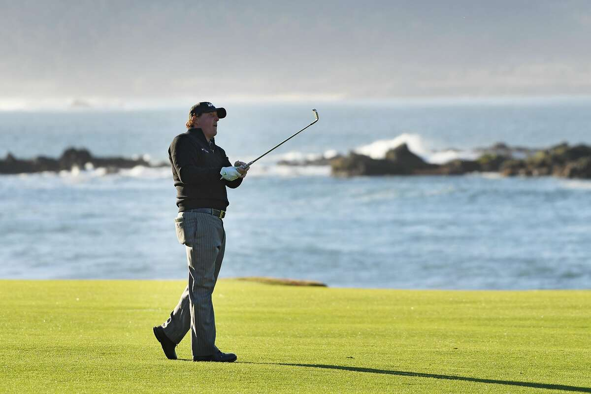 PEBBLE BEACH, CALIFORNIA - FEBRUARY 11: Phil Mickelson of the United States plays a shot on the 18th hole during the continuation of the final round of the AT&T Pebble Beach Pro-Am at Pebble Beach Golf Links on February 11, 2019 in Pebble Beach, California. (Photo by Harry How/Getty Images)