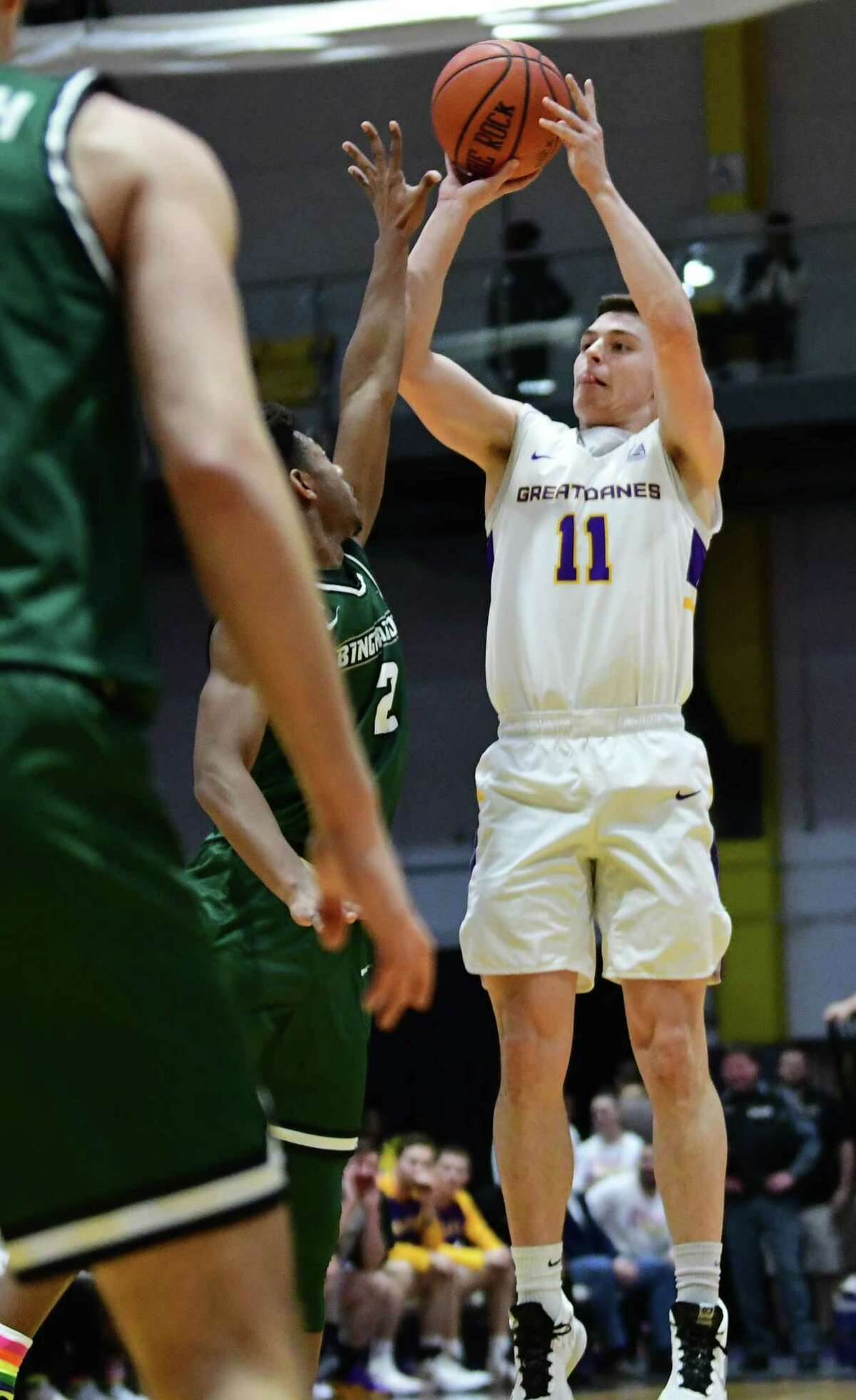 University at Albany's Cameron Healy takes a shot during a game against Binghamton at the SEFCU Arena on Wednesday, Feb. 5, 2020 in Albany, N.Y. Healy sat out for in the second half due to lower back spasms. (Lori Van Buren/Times Union)
