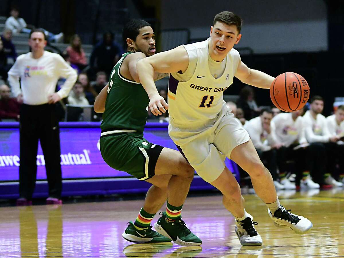 University at Albany's Cameron Healy drives to the basket during a game against Binghamton at the SEFCU Arena on Wednesday, Feb. 5, 2020 in Albany, N.Y. Healy sat out for in the second half due to lower back spasms. (Lori Van Buren/Times Union)