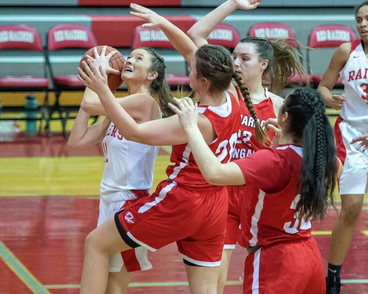 Mechanicville senior Charli Goverski drives to the basket in front of Tamarac defenders during a Wasaren League game at Mechanicville High School on Wednesday, Jan. 5, 2019 (Jim Franco/Special to the Times Union.)