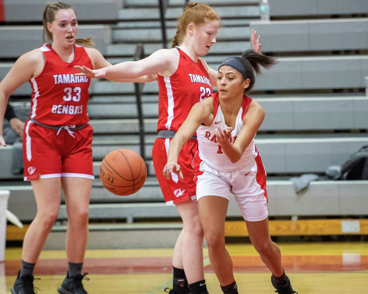 Mechanicville senior Jada Brown passes the ball in front of drives to Tamarac junior Katherine Machnick during a Wasaren League game at Mechanicville High School on Wednesday, Jan. 5, 2019 (Jim Franco/Special to the Times Union.)