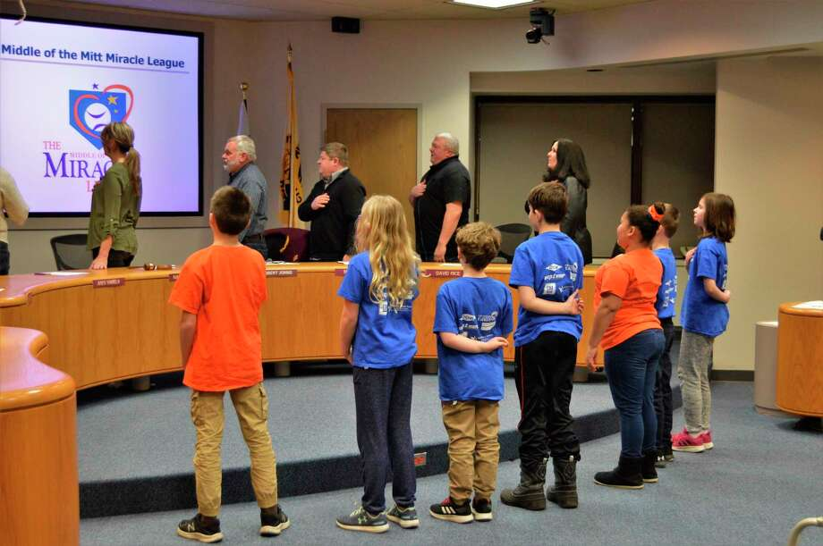 Members of Central Park and Plymouth elementary schools present their fundraising project with an audience at the Midland Parks and Recreation Commission meeting on Tuesday, Feb. 4, 2020. The Plymouth robotics team and a group of student leaders from Central Park helped raise $1,700 for playground equipment at Central Park, as part of the Miracle Field project. (Ashley Schafer/Ashley.Schafer@hearstnp.com)