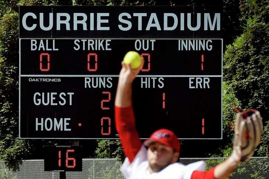 FILE — The pitching clock in the lower left-hand corner of the score board ticks down to 16 as Team USA pitcher Zane Chason pitches to a Botswana batter during the first inning of a game at Currie Stadium. (Nick King/Daily News file) / Midland Daily News