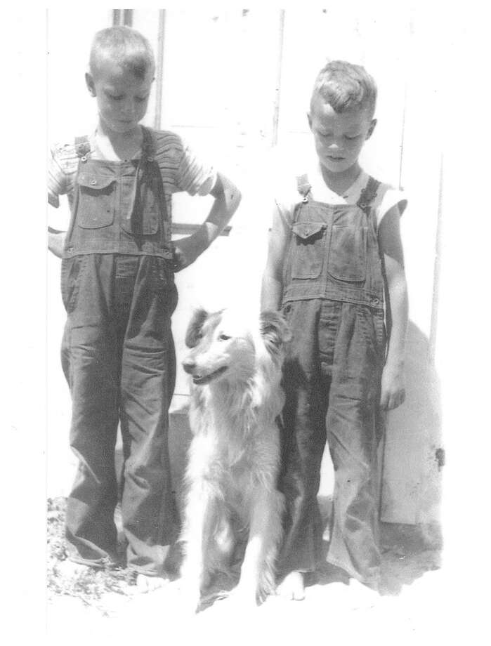 From right, Rollin Yeakle ispictured withhis brother, Raymond. Pat, the dog, sits between them. Rollin remembers what it was like growing up on Poseyville Road a few miles from the small town of Midland. (Photo provided)