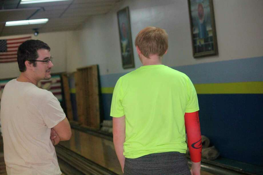 Baldwin bowling coach Donn Slimmen (left) talks with Jesse Pancio at a recent practice. (Star photo/John Raffel)